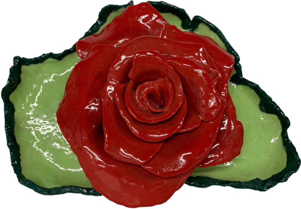 "<p align=""left""><strong><em>Rose on Leaf</em></strong></br>10 x 3.25""</br>Ceramic</br>$80</br><strong><a href=""https://checkout.square.site/buy/WJHWTZ5ZGAECAMTT2NZWKTZH"">PURCHASE</a></strong></br>"